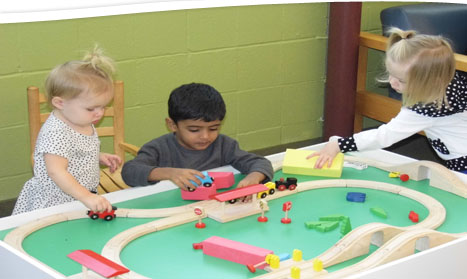 children playing with trains